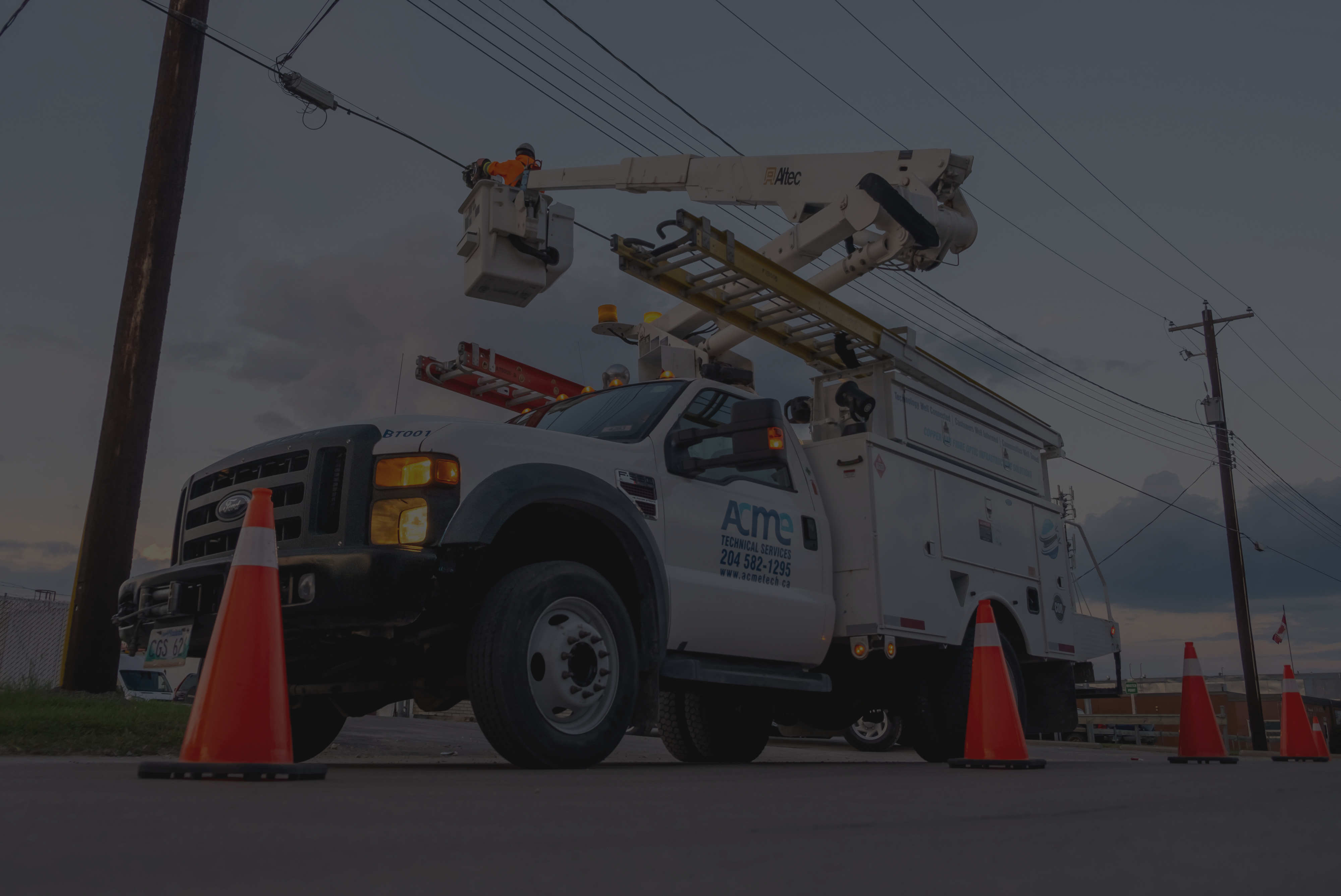 Background image of a man in a bucket truck lashing aerial copper cabling.