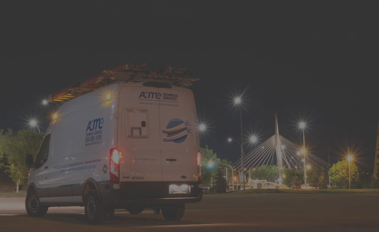 Background image of an ACME van parked by the Provencher Bridge in Winnipeg.
