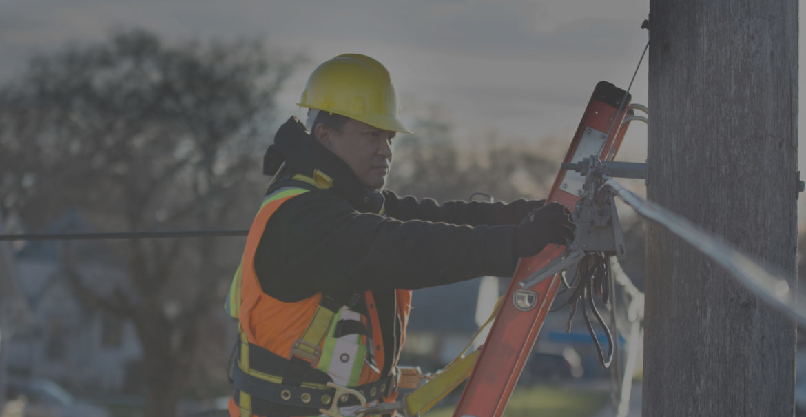 Background image of a man working in an aerial network terminal.