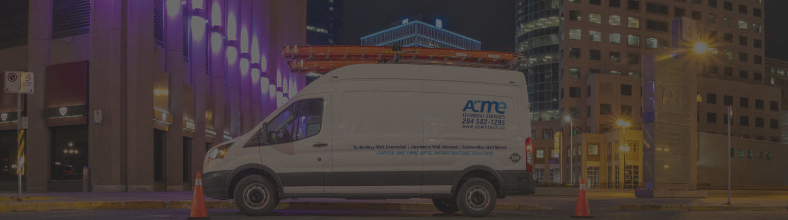 Background image of an ACME van parked in downtown Winnipeg.
